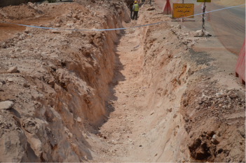 A typical narrow trench using a hydraulic breaker